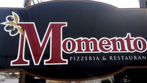 The sign outside Momentos Restaurant